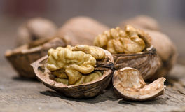 Walnuts on rustic old wooden table Royalty Free Stock Images