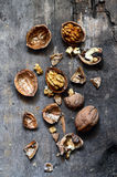 Walnuts on rustic old wooden table Stock Photography