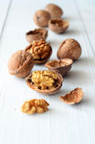 Walnuts on rustic old wooden table Stock Images