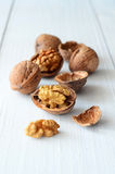 Walnuts on rustic old wooden table Stock Photos