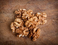 Walnuts on  wooden background Royalty Free Stock Images