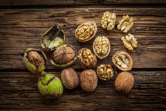 Walnuts on rustic wooden table Royalty Free Stock Photo