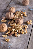 Walnuts on rustic wooden texture Stock Images