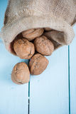 Walnuts in sack on white table. Walnuts in sack on white wooden table Stock Image