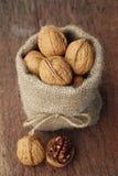 Walnuts in sackcloth bag Royalty Free Stock Photos