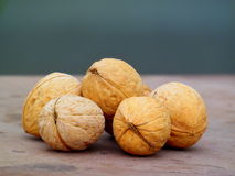 Walnuts. Several ripe walnuts on the table Stock Photography