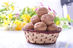 Walnuts with shell in a basket Stock Image