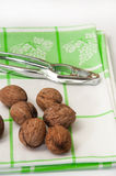 Walnuts in shell with nutcracker on the dish towel Stock Photography