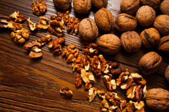 Walnuts with shell. Plenty of walnuts-  source of minerals and vitamins Stock Photos