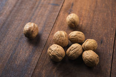 Walnuts shell on wooden table Stock Photos