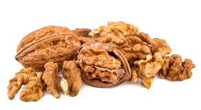 Walnuts and shelled walnuts on white background. Closeup Royalty Free Stock Photography