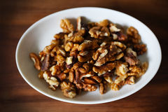 Walnuts, shelled on white plate Royalty Free Stock Image