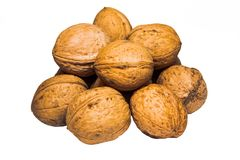 A pile of walnuts on white background. Walnuts in shells in a pile isolated on white background Royalty Free Stock Photography
