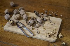 Walnuts. Some walnuts split on a wooden table Stock Image