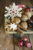 Walnuts, spices and Christmas decor Stock Photos