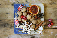 Walnuts, spices and christmas decor Royalty Free Stock Photos