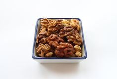Walnuts in a square shape. On a white background Royalty Free Stock Photos