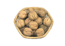 Walnuts in a straw vase isolated on white. Many walnuts in a straw vase isolated on white Royalty Free Stock Images