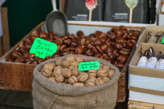 Walnuts in street market and marroni. Walnuts. Walnut on market, Italy. Fresh walnuts Stock Images