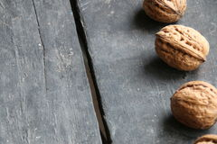 Walnuts on the table. Food background. Stock Images