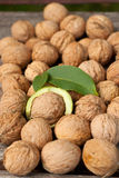 Walnuts. On the table with leaves Royalty Free Stock Photography