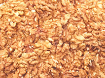 Walnuts are the texture. The texture of shelled walnuts Royalty Free Stock Photography