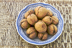 Walnuts to bowl Stock Photo