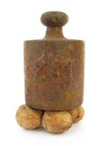 Walnuts under old iron weight Stock Image