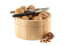 Walnuts in utensil with nutcracker Stock Image