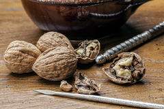 Walnuts and utensils on table. Royalty Free Stock Photos