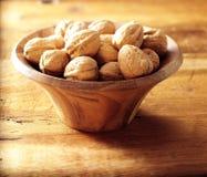 Walnuts in walnut bowl Stock Photography