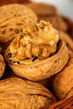 Walnuts and walnut kernel in a wicker basket Royalty Free Stock Image