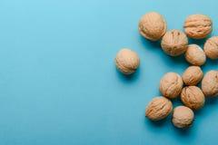 Walnuts, walnuts close-up, walnuts on blue background, Stock Images