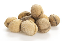 Walnuts on white. Walnuts on a white background Royalty Free Stock Photos