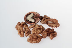 Walnuts on white background. Cracked and uncracked stock image