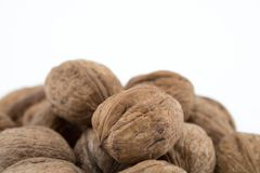 Walnuts on white background. The health benefits of walnuts are many. And include reduction of cholesterol, weight management, and diabetes control stock image
