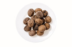 Walnuts on white background and a plate Stock Photo