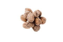 Walnuts on white background and a plate Royalty Free Stock Images