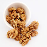 Walnuts in a white bowl Royalty Free Stock Photo