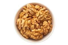 Walnuts in white bowl Stock Photo