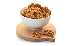Walnuts in white bowl Royalty Free Stock Images