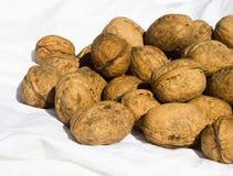 Walnuts on white fabric Stock Photo