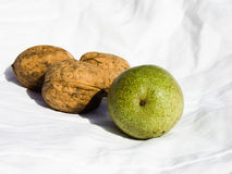 Walnuts on white fabric Stock Images