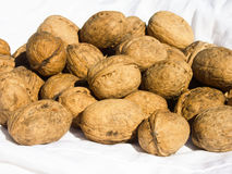 Walnuts on white fabric Royalty Free Stock Photo