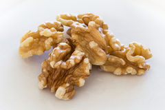 Walnuts on a white plate Royalty Free Stock Photo