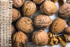 Walnuts on a white table with a bag Stock Photography