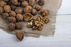 Walnuts on a white table with a bag Stock Images