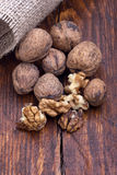 Walnuts on a white table with a bag Stock Photo