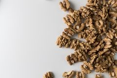 Walnuts on a white table. Close up view. Nuts for health. Selective focus.  stock images