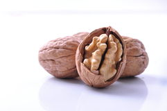 Walnuts on white Stock Images